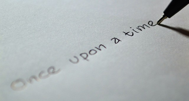pen writing text on paper