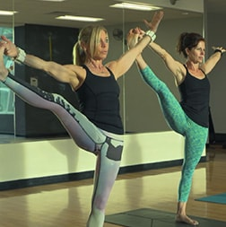 women stretching in gym
